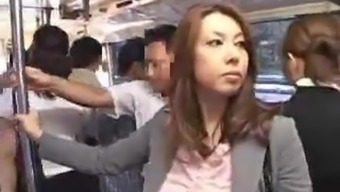 Hot asians are trying to have sex in a public bus.