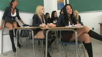 Hardcore schoolgirls are posing in the classroom