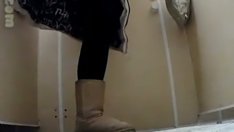 White chick in uggs and coat pisses in the public toilet
