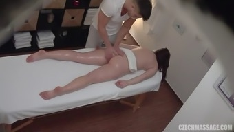 Czech hottie gets fingered and cums on massage table