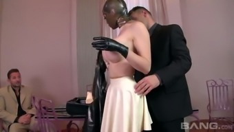 Submissive buxom maid Lucy Latex is gonna please her boss and his kinky buddy