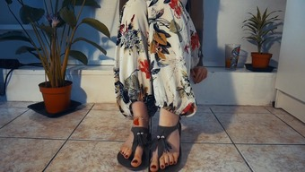 Boho bitch in sandals and jewelry