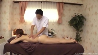 Japanese model with an arousing body gets an erotic massage