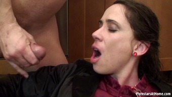 Juicy brunette moans in jubilation while riding a huge cock on the kitchen floor