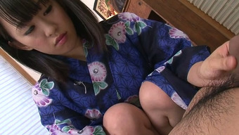 Sweet Asian bitch in sexy kimono pleases her stud with nice BJ in massage parlor