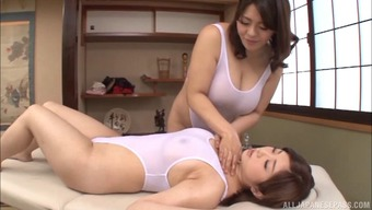 Huge titty Japanese masseuse seduces a girl and screws her