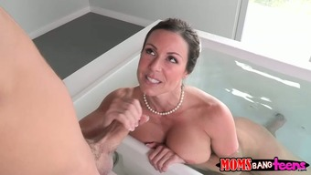 Busty lewd brunette wins a chance to suck a delicious dick in bathroom