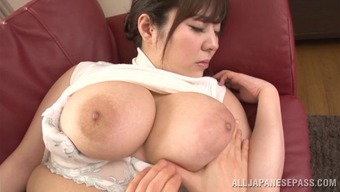 Wonderful Asian milf with big tits giving a steamy handjob