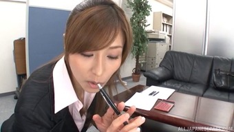 Office beauty in fishnets gets on her knees and blows her boss