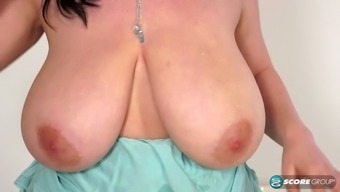 Nude fat brunette with huge tits rubs her meat hole