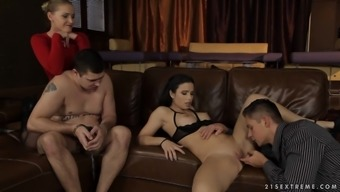 Brunette being drilled on leather sofa by two dicks