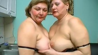 Enjoy nasty moms masturbating together