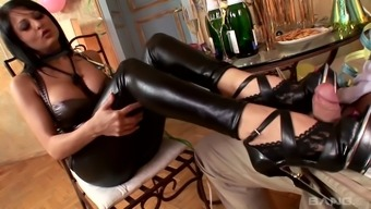 Alison Star loves wearing leather pants and she gives a great footjob