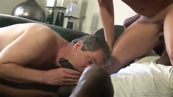 Busty blonde milf and her bisexual hubby give a blowjob to a black guy