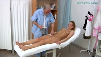 Tempting blonde babe enjoys being fingered by her horny doctor
