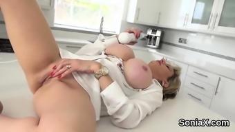 Adulterous english milf lady sonia showcases her giant boobs