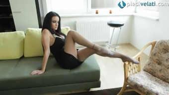 In her pantyhose she strips off her dress to show her legs and body