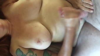 Tug job onto her tits