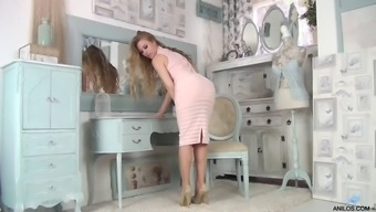 Long haired tease shows off her new tight dress