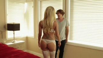 Stunning blondie in white stockings Capri Cavanni gets her nipples sucked by her dude