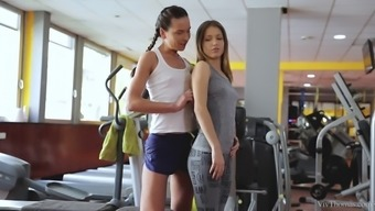 Wicked lesbian babes lick each other in the gym