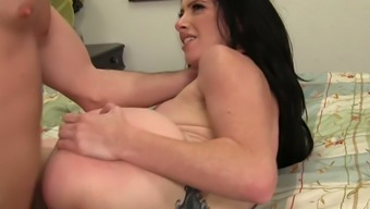 Ardent bosomy cowgirl with tattooed back Bella Maree jumps on dick