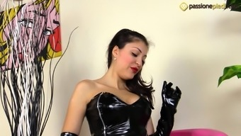 Sexy Eden is wearing leather clothes and wants you to see her feet
