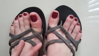 Sweet pointed feet playing with flip-flops.
