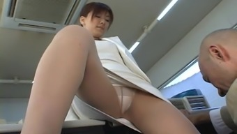 Japanese sweetie gets her pussy massaged with a vibrator
