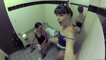 Lesbian babes sneak into the bathroom to each each other out