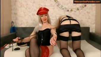 Mistress in a wonderful  lingerie is slapping her slave chick