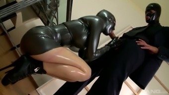 Latex bitch Lucy Latex gets her muff banged by horny and kinky mater