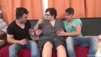Horny mature chick wants to fuck with two young guys at once