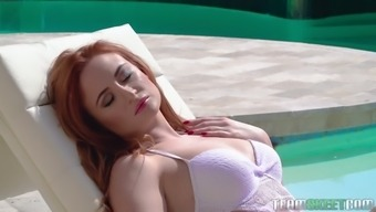 Russian red haired babe Eva Berger gives a blowjob and gets fucked by the poolside