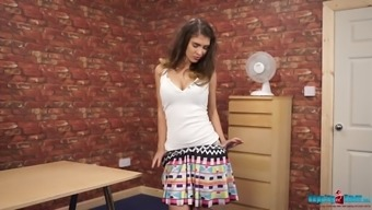 Lovely svelte gal called Katie Louise plays naughty and undresses