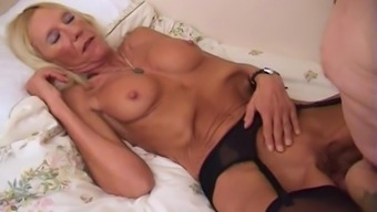 Hot blonde granny is happy to be ravished by a stallion