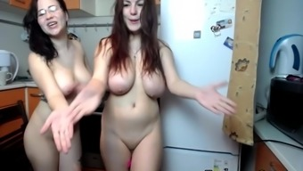 Beautiful lesbian chick having a good time naked and playing with each others pussies
