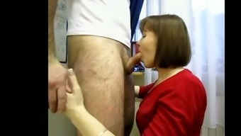Watch my hot brunette wife sucking and rubbing my dick