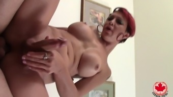 Sexy redheaded tgirl fucked in the butt by a stiff dick