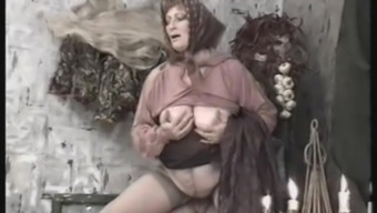 Grandma with a plump belly and sexy stockings has hot sex