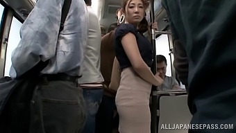 Sexy Japanese girl with an awesome body getting her pussy fingered on a bus