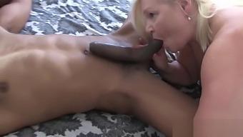 Grandma blows black cock at glory hole