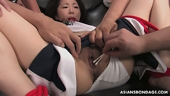 Japanese girl Ai Mizushima is fucked by several dudes with vibrators