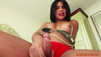 Horny Thai shemale whore Jessy shakes and spanks her ass.