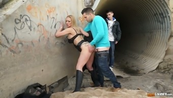 Incredibly hot busty blond head Daniela Evans gets fucked from behind outdoors
