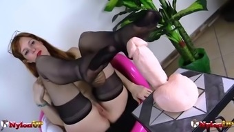 Redhead sucks her toes in stockings then gives footjob