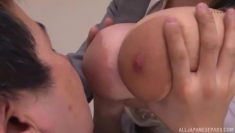Japanese busty secretary Yuuki Iori gives a titjob with her huge boobs