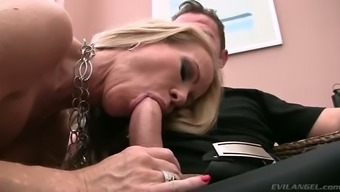Sexy blond haired MILF with big chain on her neck shows off stout deep throat