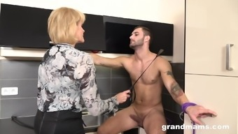 Mature mistress spanks her male slave and makes him cum in her mouth