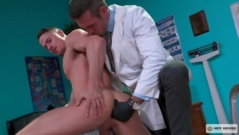 Kinky gay doctor fucks his patient doggy style on the table